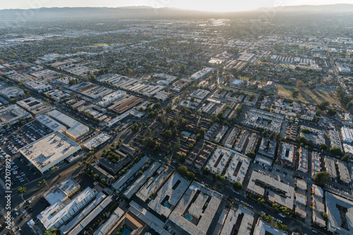 Afternoon aerial of apartment rooftops in the San Fernando Valley region of Los Angeles, California.
