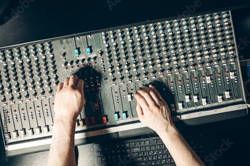 top view shot.man regulating the volume. profession, job concept