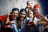 group of excited crazy rappers posing to the camera. hobby, people, free time concept. challenge
