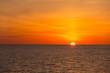 Quadro Wschodzące słońce na morzu