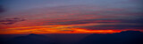 Fiery sunset from mountain peak in a cloudy evening. Fall season. Orobie mountains. Italian Alps