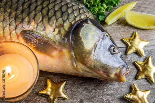 Czech christmas time and customs - bohemian cuisine and typical fish - traditional carp prepared for festive dinner cooking - 237110911