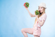 Young woman holding radish