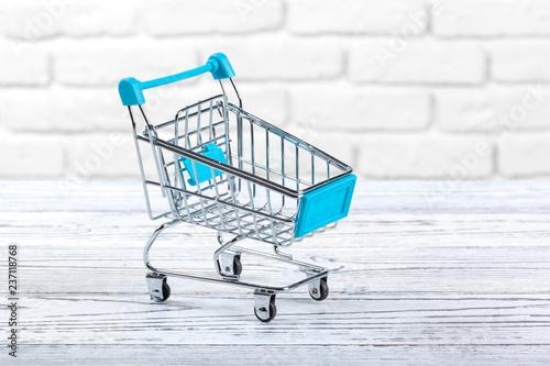 Leinwandbild Motiv Mini Shopping Cart On The Table.