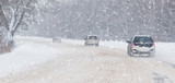 Winter, snow, Blizzard, poor visibility on the road. Car during a Blizzard on the road with the headlights. - 237122348