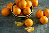 A lot of tangerines on a wooden background.