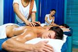 Thai therapist doing massage with hot stones. - 237129143
