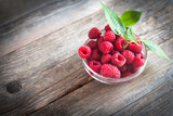 fresh raspberries on a wooden table