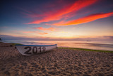Boat on the beach and sea sunrise, New year 2019 concept.