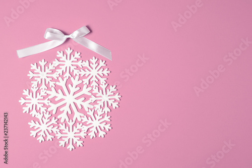 Christmas or winter composition minimal concept. New year bauble or ball made of white snowflakes flat lay on pastel pink background. top view. copy space - 237142143