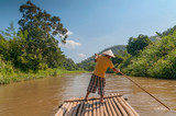 Bamboo rafting in tropical forest near Chiang Mai, Thailand.