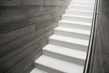 Modern reinforced concrete staircase with stainless handrail in interior of contemporary house, New stairs made of raw concrete
