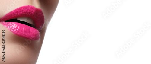 Leinwandbild Motiv Close-up of woman's lips with bright fashion pink glossy makeup