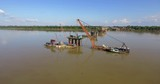 drone shot of bridges foundations and  barges mounted cranes in river - 237194971