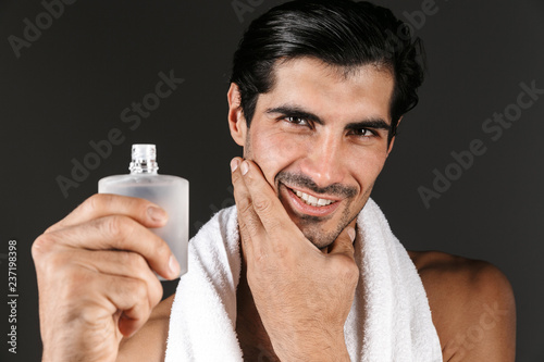 Leinwandbild Motiv Handsome shirtless man with towel