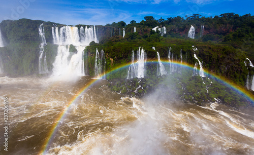 Rainbow over Cataratas del Iguazu waterfall, Brazil