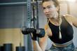 Leinwandbild Motiv  Woman in a gym lifting weights