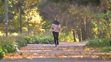 Muslim woman in hijab goes jogging in autumnal park - 237231960