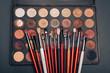 makeup brush set and professional eye shadow palette to make feminine beauty