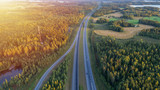 Aerial view of road through countryside and cultivated field - 237237165