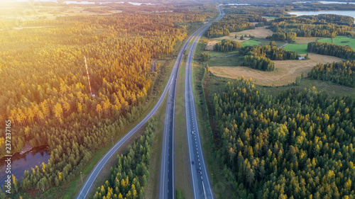 Aerial view of road through countryside and cultivated field