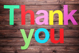 Words Thank you by paper letters on brown wooden table - 237240399