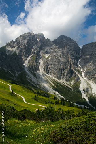 Valley in the Alps (Austria, Europe). Beautiful nature, high mountains, summer day, snowy peaks. Hike in the rocks, traveling with a backpack. - 237243756
