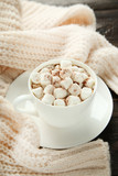 Cappuccino with marshmallows in cup and knitted scarf on wooden table - 237246704