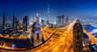 Leinwanddruck Bild - Dubai skyline at night, panoramic aerial top view to downtown city center landmarks. Famous viewpoint, United Arab Emirates