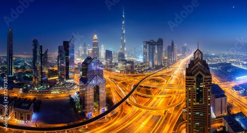 Leinwanddruck Bild Dubai skyline at night, panoramic aerial top view to downtown city center landmarks. Famous viewpoint, United Arab Emirates