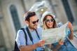 Leinwandbild Motiv Tourist couple in love enjoying city sightseeing