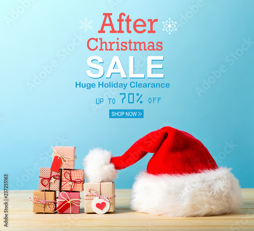 After Christmas sale message with a Santa hat and tiny Christmas gift boxes