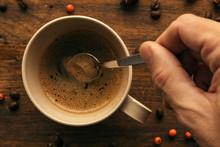 """Постер, картина, фотообои """"Hand steering coffee in a cup with spoon"""""""