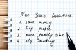 New year resolution in notepad with pen