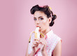 pretty girl in vintage style. pinup girl with fashion hair. banana dieting. pin up woman with trendy makeup. retro woman eating banana, copy space. Taking order on fruits