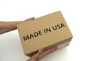 Man delivers carton with MADE IN USA text on it - 237276541