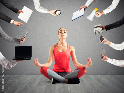 Fototapeta Woman tries to keep calm with yoga due to stress and overwork at wok