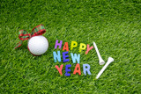 Golf Happy New Year with golf ball on green grass