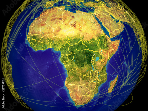 Africa from space on Earth with country borders and lines representing international communication, travel, connections.