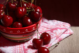 A bowl with ripe cherry