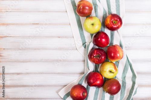 Leinwanddruck Bild Sweet apples on wooden background
