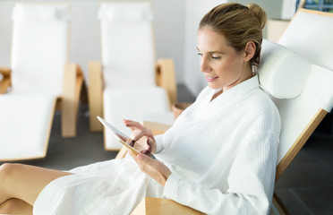Beautiful woman relaxing and using tablet in spa © nd3000