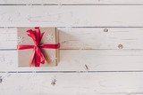 Brown gift box and Christmas presents on white wooden table background. - 237342769