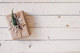 Brown gift box and Christmas presents on white wooden table background. - 237342794