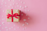 Brown gift box on the pink background with christmas decoration. Minimal styled holiday card with copy space. - 237343706