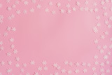 Top view Christmas snowflake border frame on pink background. Xmas minimal texture with copy space. - 237343723