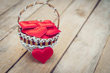 Red heart in basket on wooden table for valentine day and love concept with copy space. - 237343783