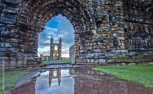 Leinwanddruck Bild Reflection in the Water of the St Andrews Cathedral in St. Andrews, Scotland