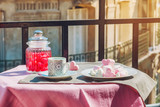 Paris lifestyle. Sweets and coffe on a balcony