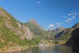 Sea gulf, mountains and settlement. Geiranger, Norway